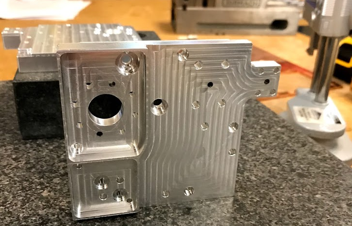 Photo shows Fabrisonic's 3D printed heat exchanger at the NASA JPL Lab. Photo via Fabrisonic.