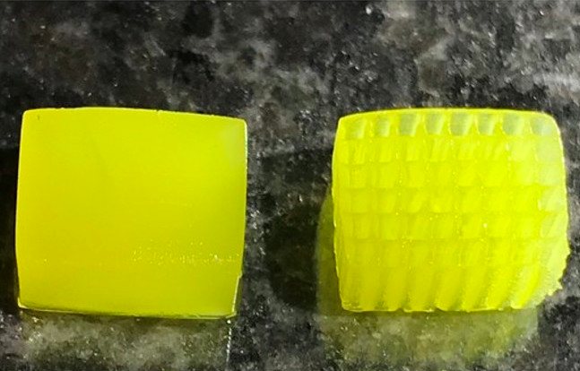 An image of a cube and grid-shaped 3D printed energy absorbing structure.