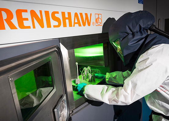 An image of a BAE Systems engineer using a Renishaw 3D printer.