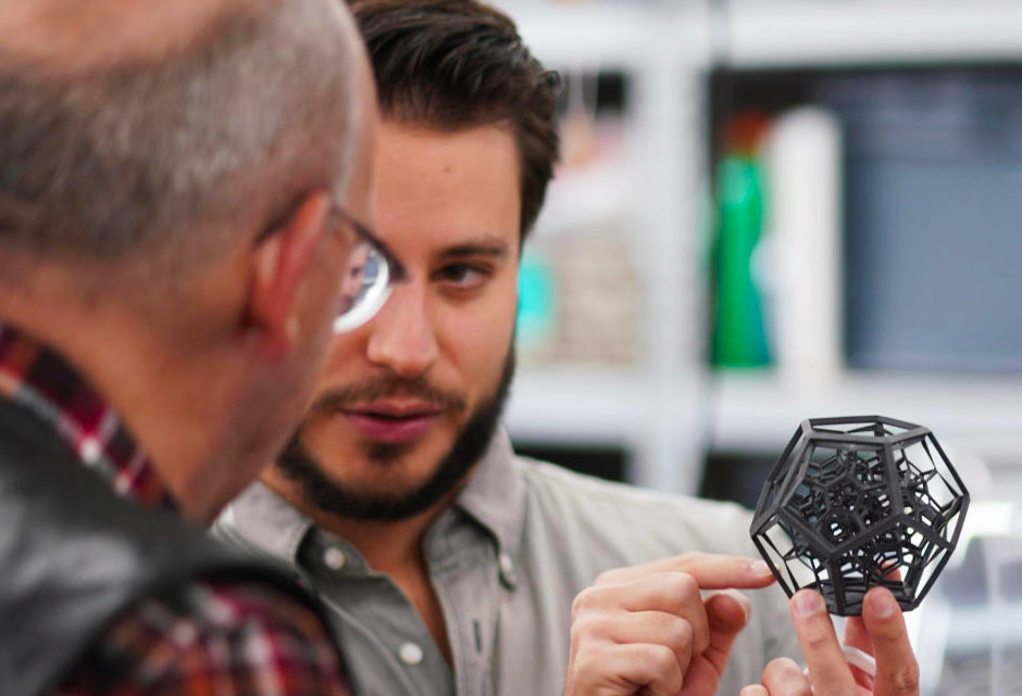 A Sinterit engineer explaining the format of a 3D printed part to a client