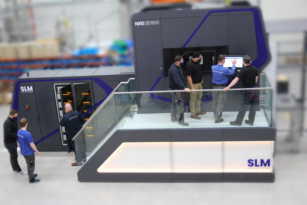 A team of SLM engineers being trained in Lubeck to use the NXG XII 600 3D printer