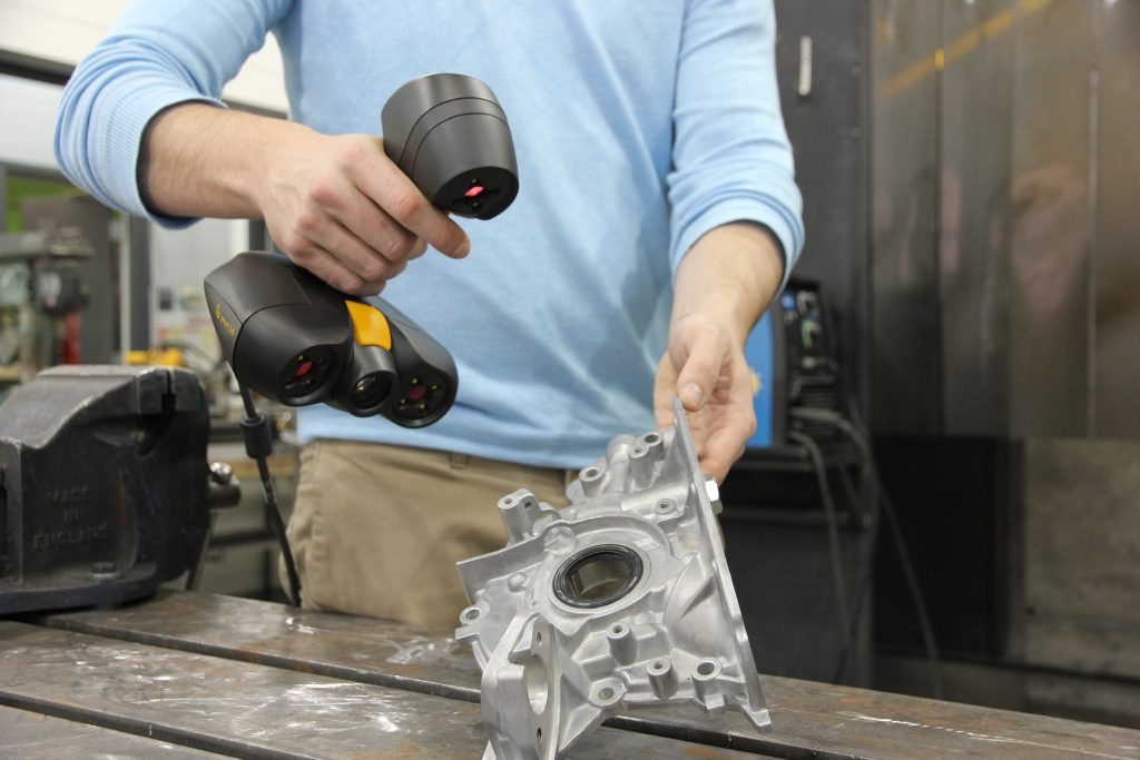 The peel 2 CAD-S scanning a casted metal part. Photo via peel 3d.