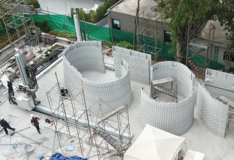 Mid-construction of SCG's 3D printed co-working building. Image via SCG.