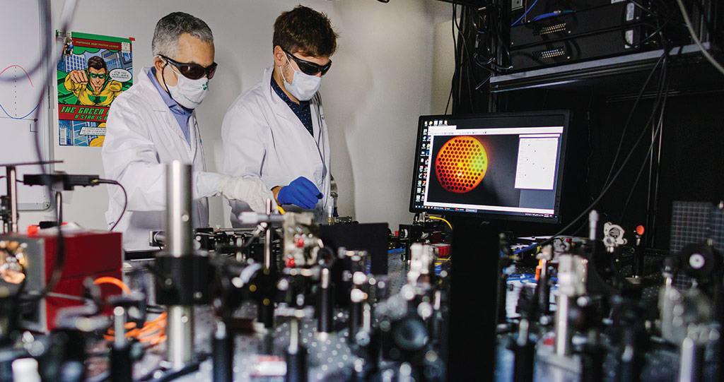 Study co-authors Andrea Bertoncini and Carlo Liberale 3D printing optical fibers in the lab. Photo via KAUST.