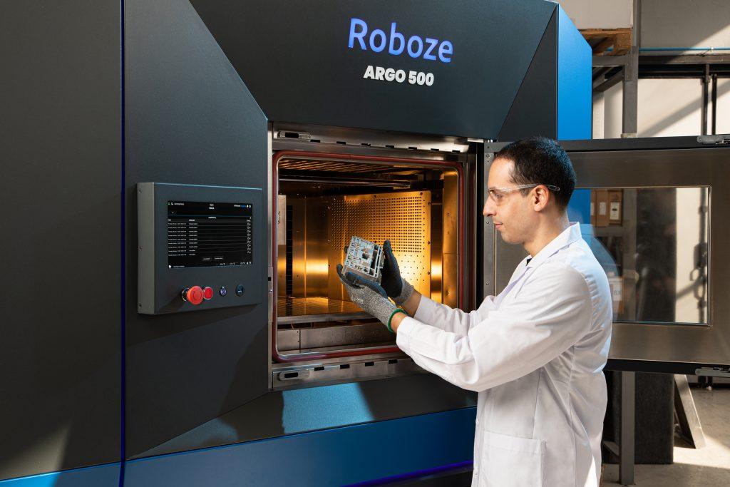An engineer using ROBOZE's ARGO 500 3D printer.