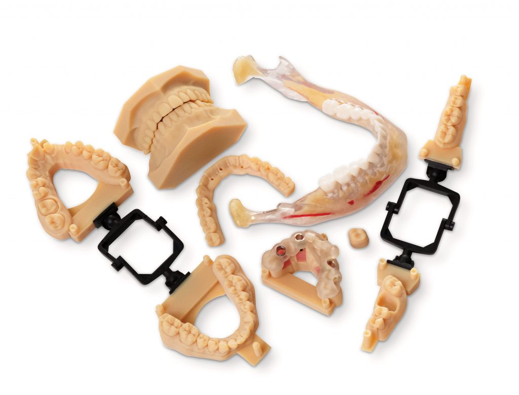 Dental parts 3D printed with the J5 DentaJet. Photo via Stratasys.