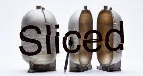 a titanium fuel tank printed on a VELO3D additive manufacturing system with the Sliced logo.