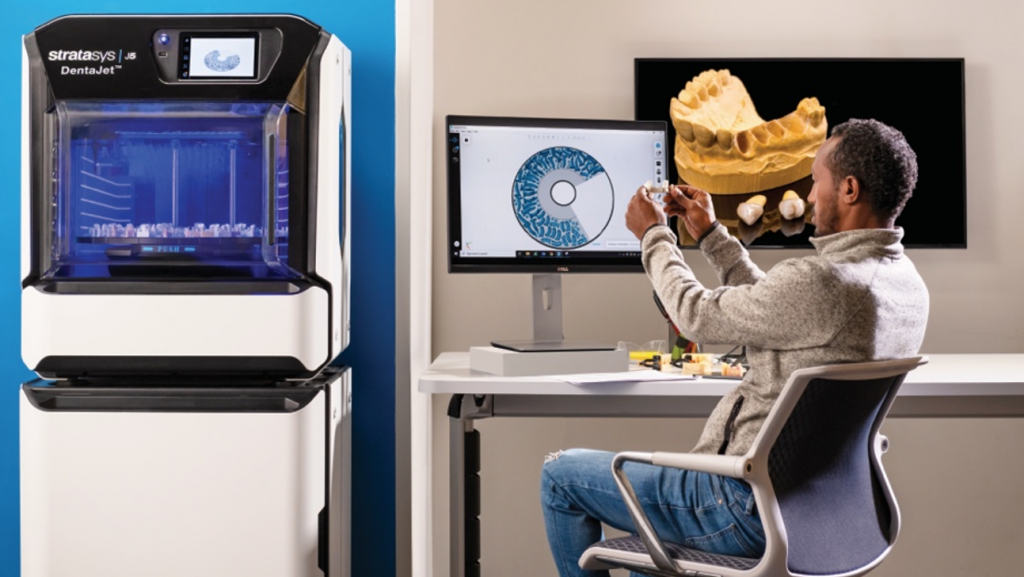 The J5 DentaJet can print with up to five bioresins in a single build. Photo via Stratasys.