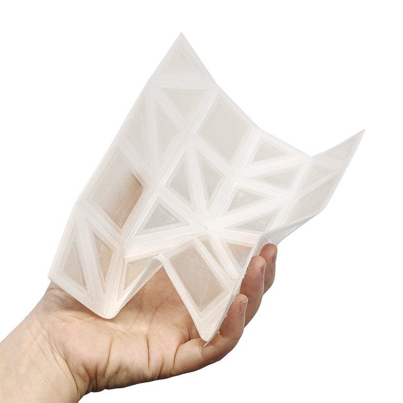 A foldable 3D printed PLA-TPU panel. Photo via UCL.