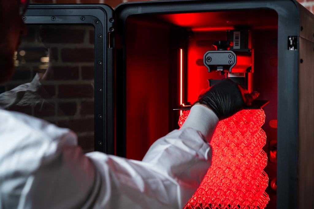 An engineer using the Origin One 3D printer.