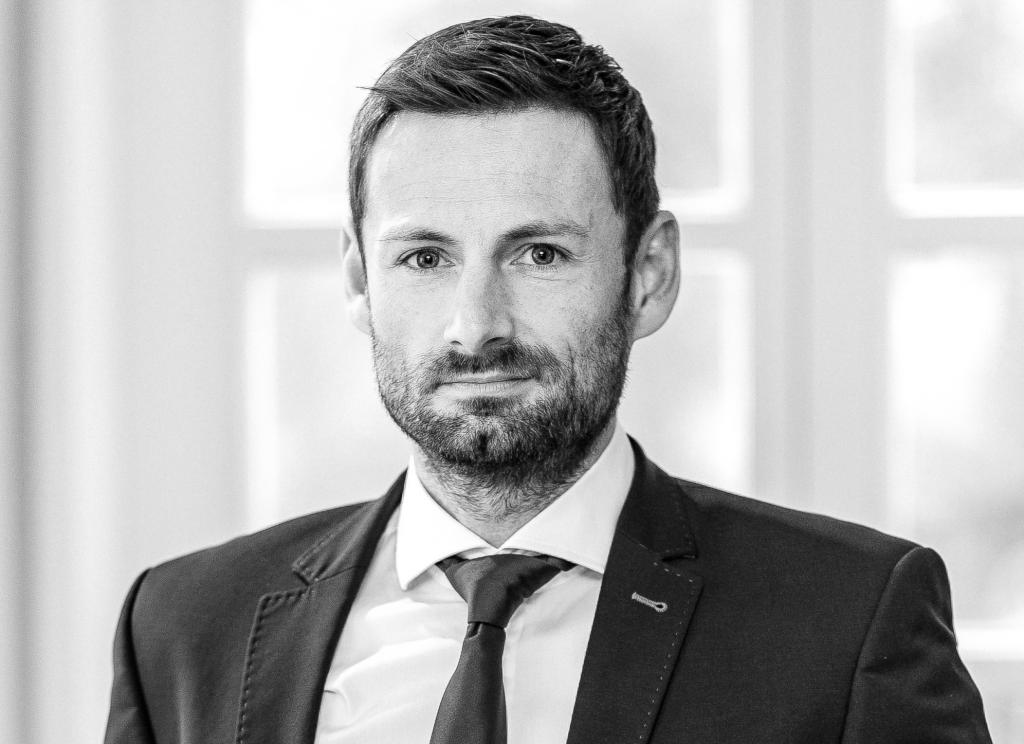 Greyscale image of AMKmotion Managing Director Stefan Buchner.