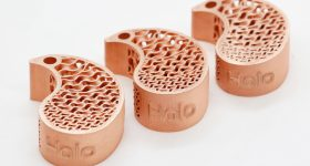 3D printed copper keychains using Holo's PureForm technology. Photo via Holo.