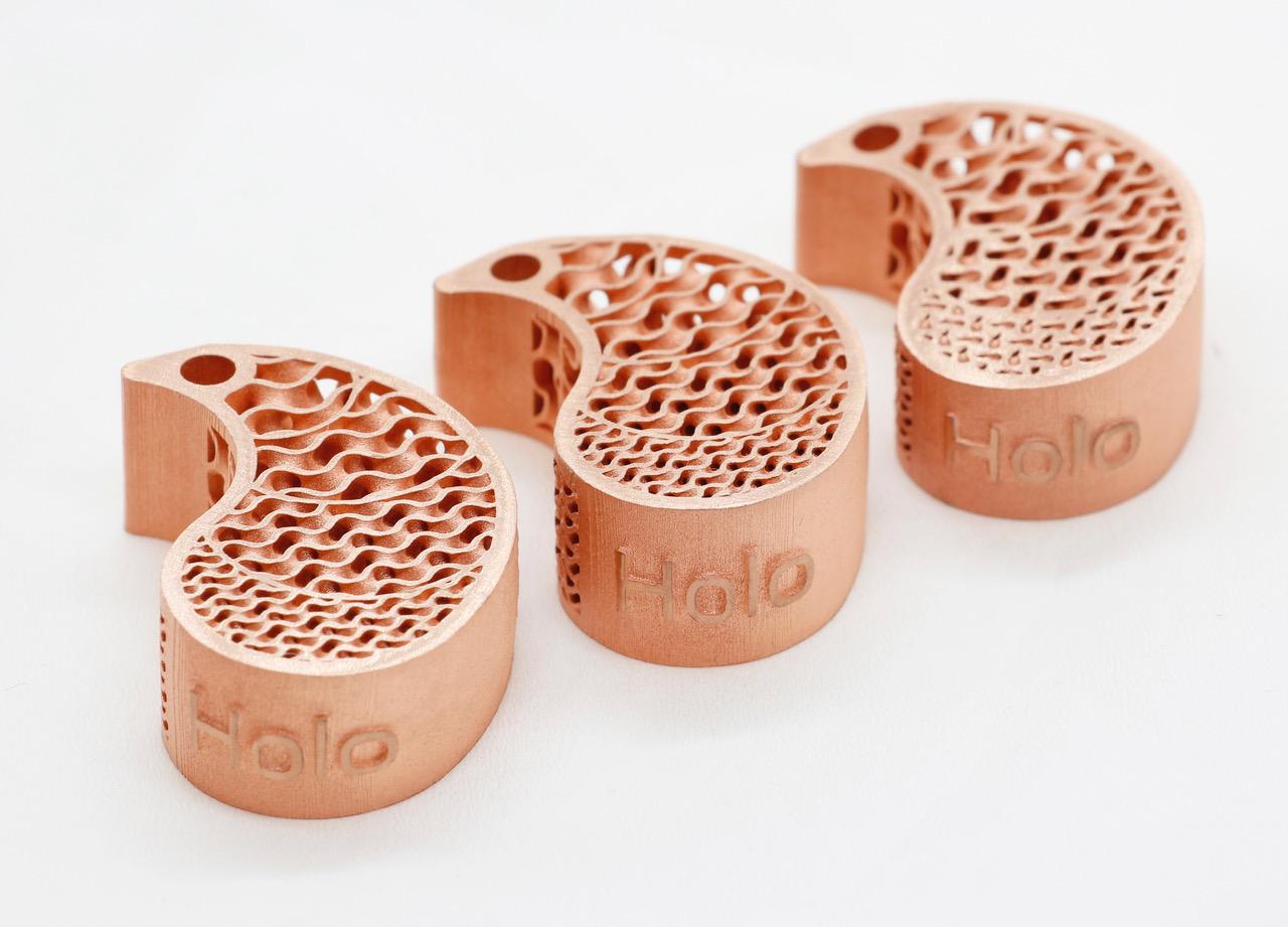 3D printed copper keychains using Holo's PureForm technology. Photo via Holo.