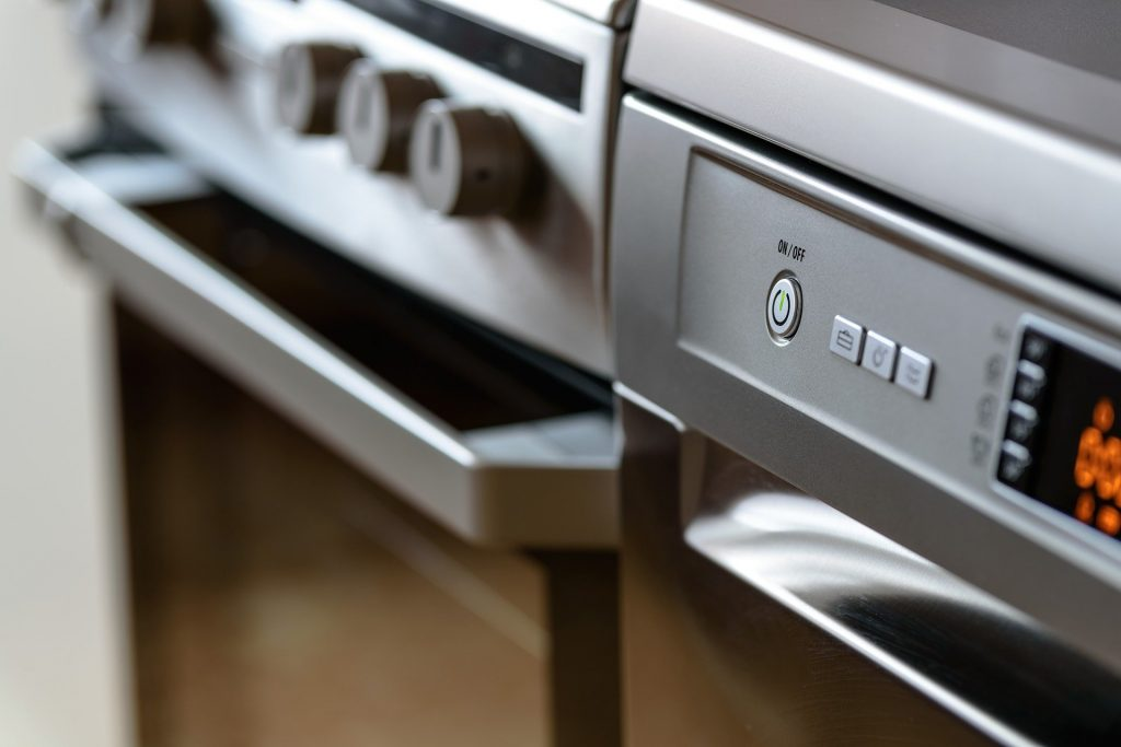 Modern oven and Dishwasher appliances.