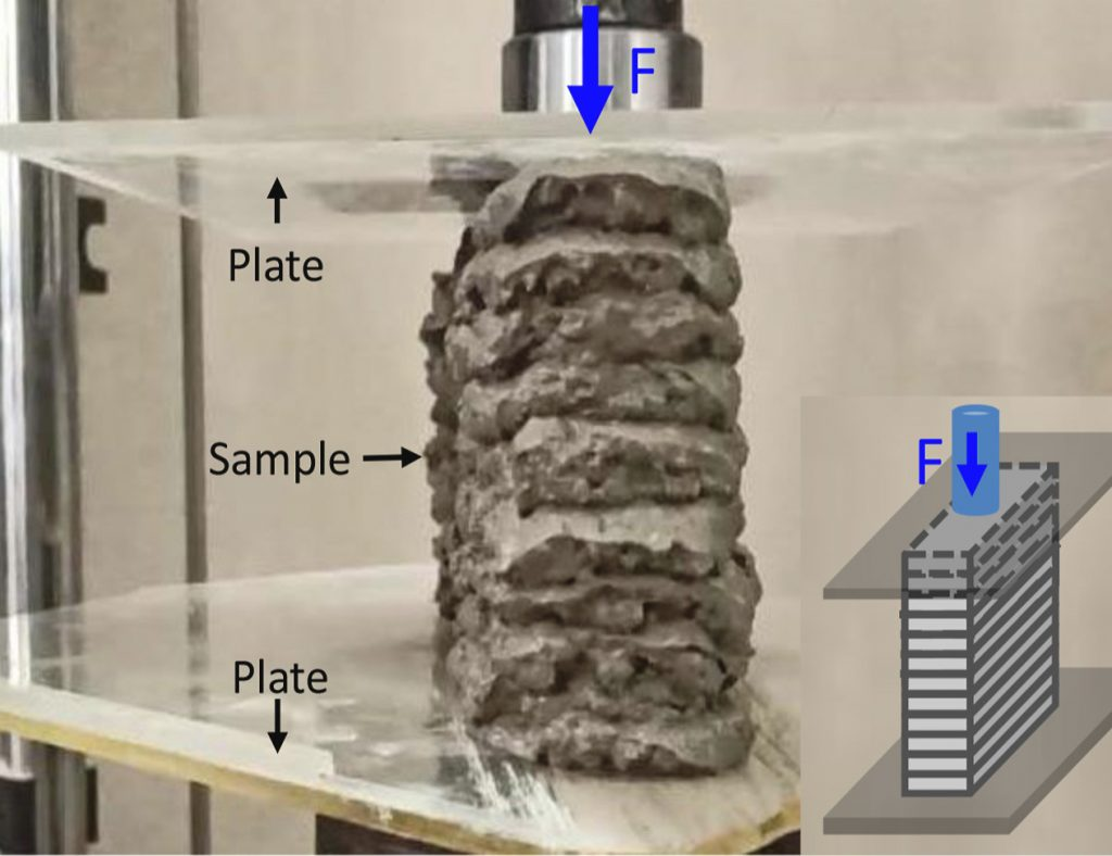 One of the researchers' 3D printed concrete structures being subjected to compression testing.