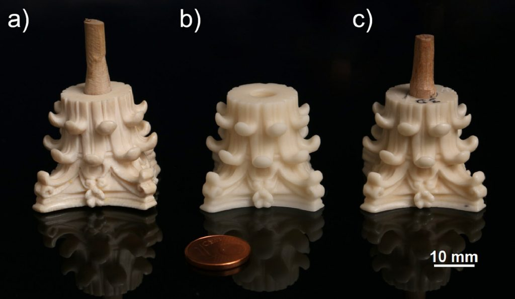 The original ivory capital alongside the 3D printed replicas, before and after post-processing.