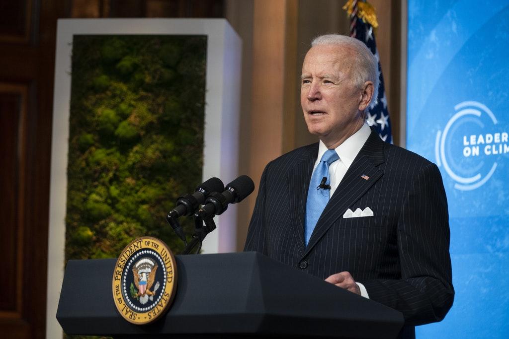 President Joe Biden at the Climate Summit. Photo via Evan Vucci/Associated Press.