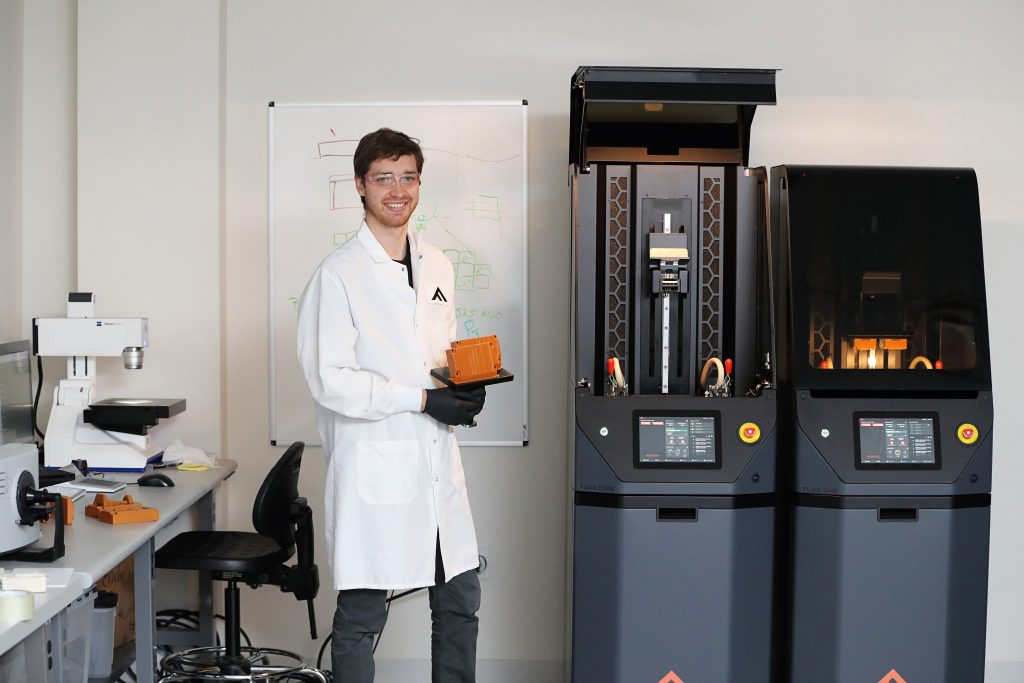 The FLUX Core and FLUX One 3D printers. Photo via Fortify.