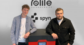 Rotite's Product Design Engineer Connor Whyley alongside the Sinterit Lisa Pro 3D printer.
