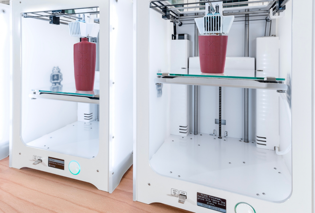 Two 3D printers being used to create L'Oréal prototypes.
