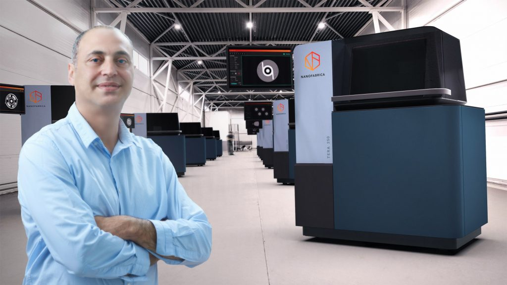 Avi Cohen and a fleet of Nanofabrica Tera 250 3D printers. Photo via Nanofabrica.