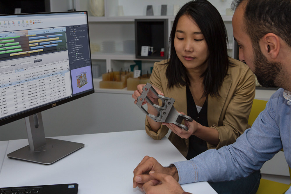 Two people designing a 3D printed part using Materialise's Streamics software.