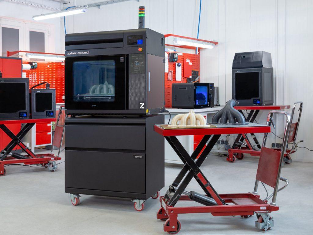 Zortrax's Endureal 3D printer alongside some industrial parts.  - ZORTRAX Endureal 2 1024x769 - Zortrax launches new space-grade Z-PEEK 3D printing filament