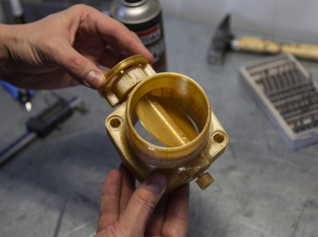 An Endureal 3D printed throttle body part.