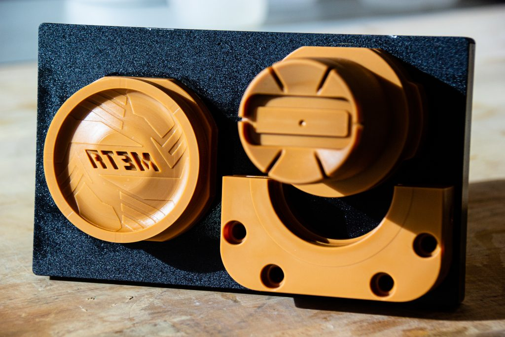 A mold tool and inserts on the build plate Fortify's 3D printed mold tool solution can include inserts, hand loads, side action depending on your part geometry. Photo via Fortify.