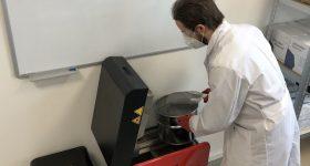 An engineer filling Sinterit's Lisa 3D printer at Gautzsch's AM Hub. Photo via Sinterit.