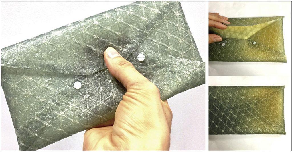 A purse 3D printed using silk leather. Photo via Tufts University.