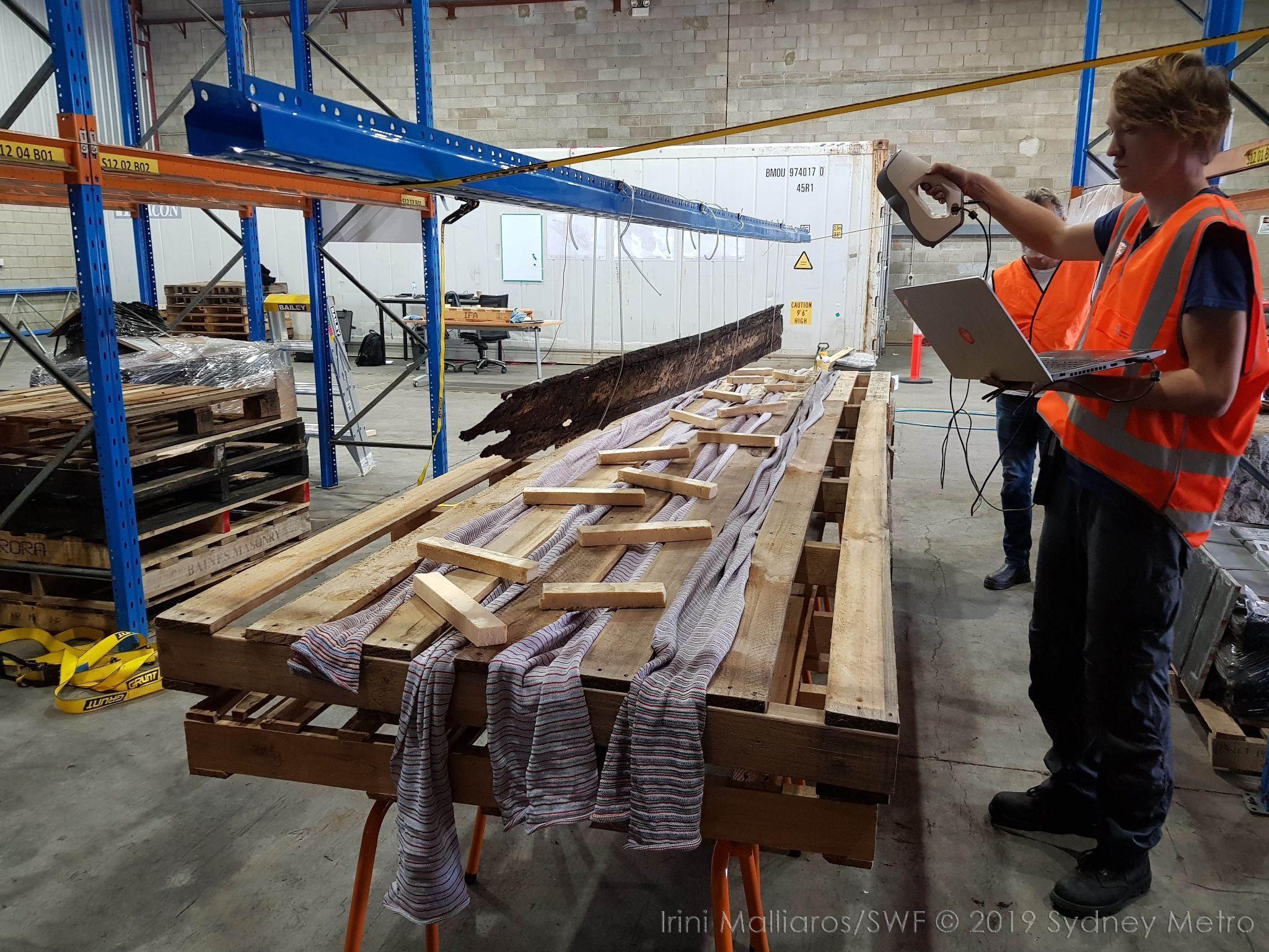 Thomas van Damme demonstrates the scanning technique for the long, thin timber planks of the Barangaroo Boat. Photo via Irini Malliaros / Silentworld Foundation / Sydney Metro.