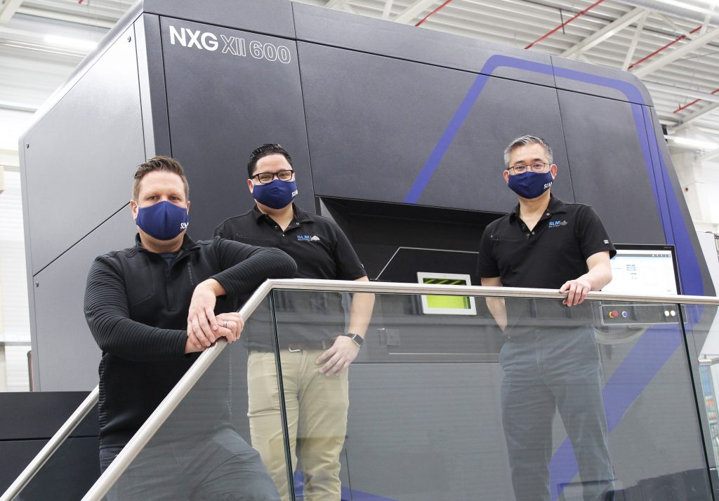 SLM Solutions team members being trained on its new NXG XII 600 3D printer.