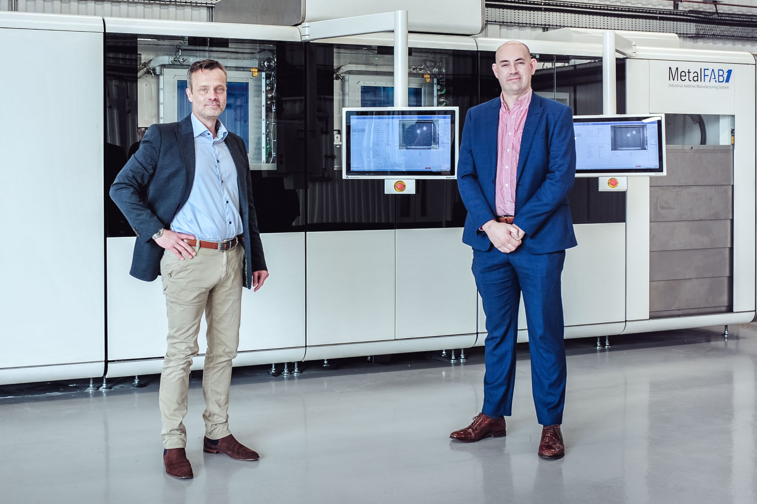 Picture of Lars Ryberg, Director Business Development UK & Ireland (left), inspecting the MetalFAB1 with Mike Curtis-Rouse (right) Head of Manufacturing for Space at Satellite Applications Catapult. Photo via Additive Industries.