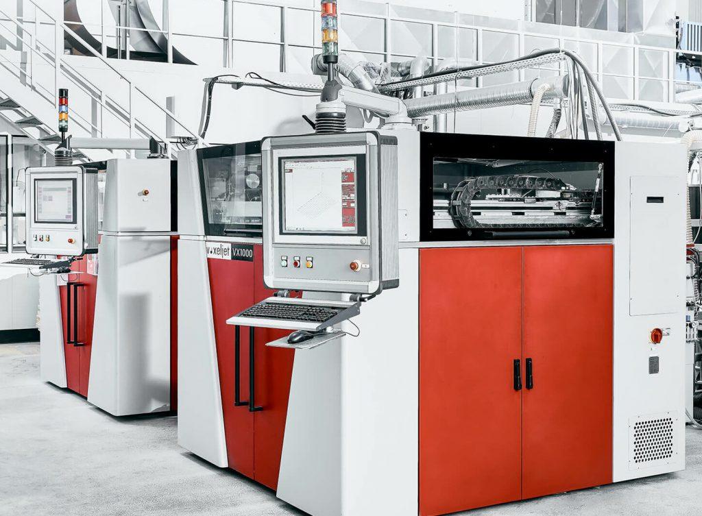 Two of voxeljet's VX1000 3D printers.