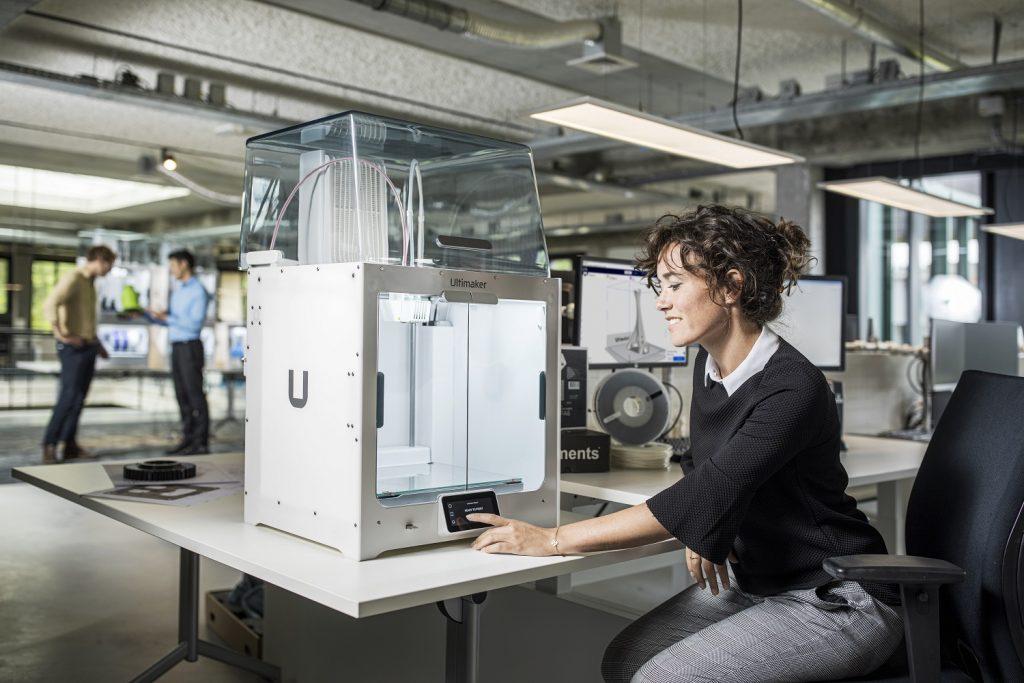 An engineer using an Ultimaker 3D printer.