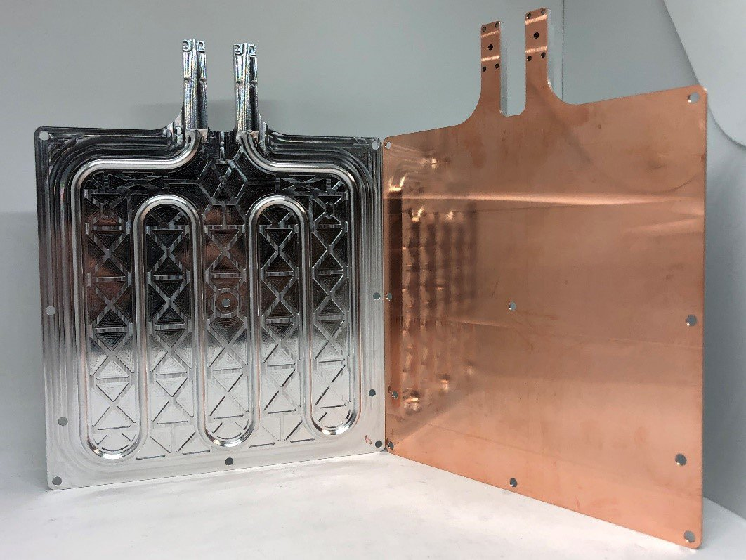 This 3D printed radiator for a CubeSate combines aluminum and copper to allow heat the spread more evenly across the face. Photo via Fabrisonic.