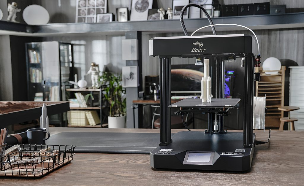 Creality's Ender-7 3D printer on a workbench.