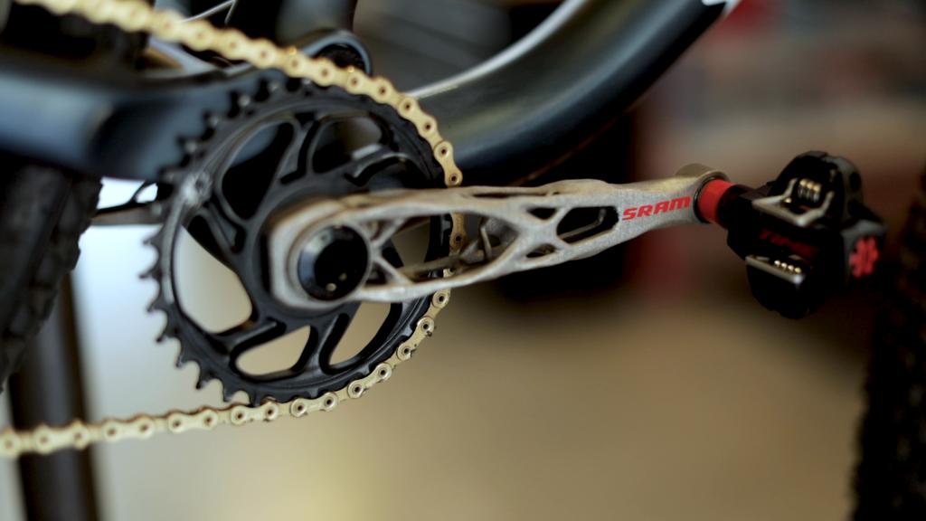 A generatively designed bike crank arm 3D printed by SRAM. Photo via Autodesk.