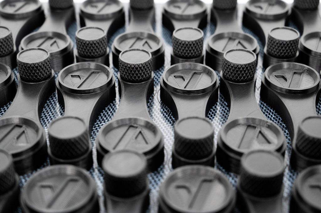 End-use handles 3D printed on the AON M2+. Photo via AON3D.