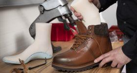 A shoe last being used to make custom footwear.
