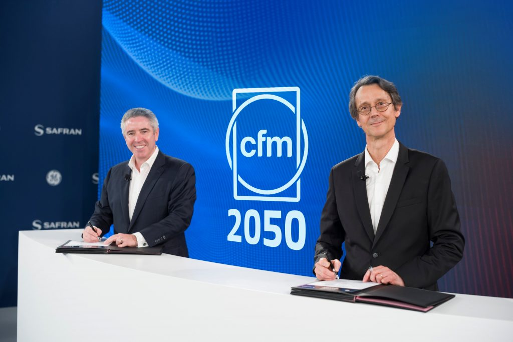 John Slattery, President and CEO of GE Aviation and Olivier Andriès, CEO of Safran sign agreement extending the CFM International partnership to 2050. Photo via CFM International.
