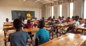 Malawian school children receiving teaching in the world's first 3D printed school made by 14Trees with a COBOD BOD2 printer. Photo via Bennie Khanyizira.