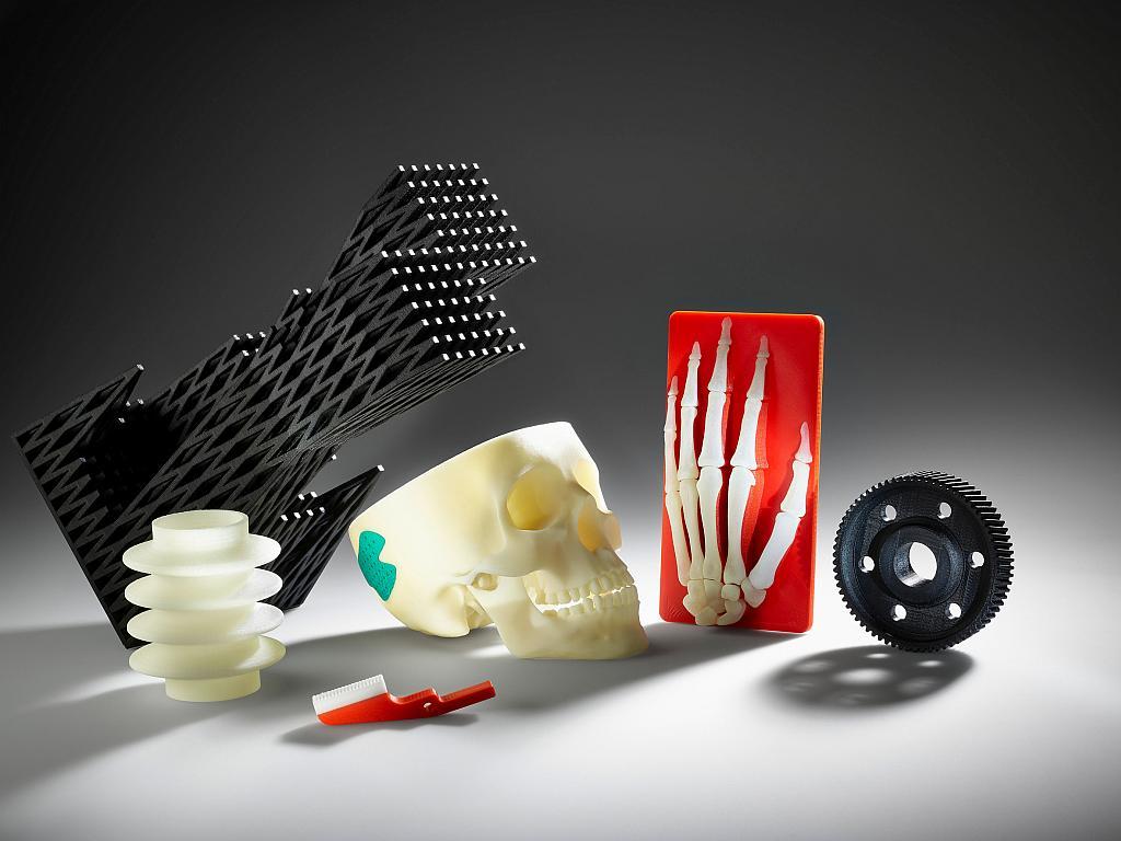 Multimaterial parts 3D printed on the Freeformer. Photo via Arburg.