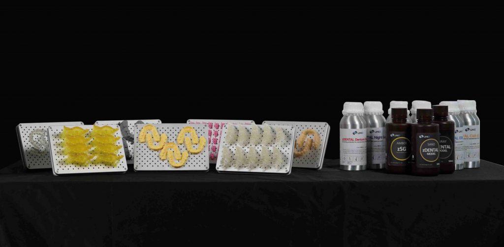 UNIZ's extensive portfolio of zDental resins available for use with the NBEE. Photo via UNIZ.