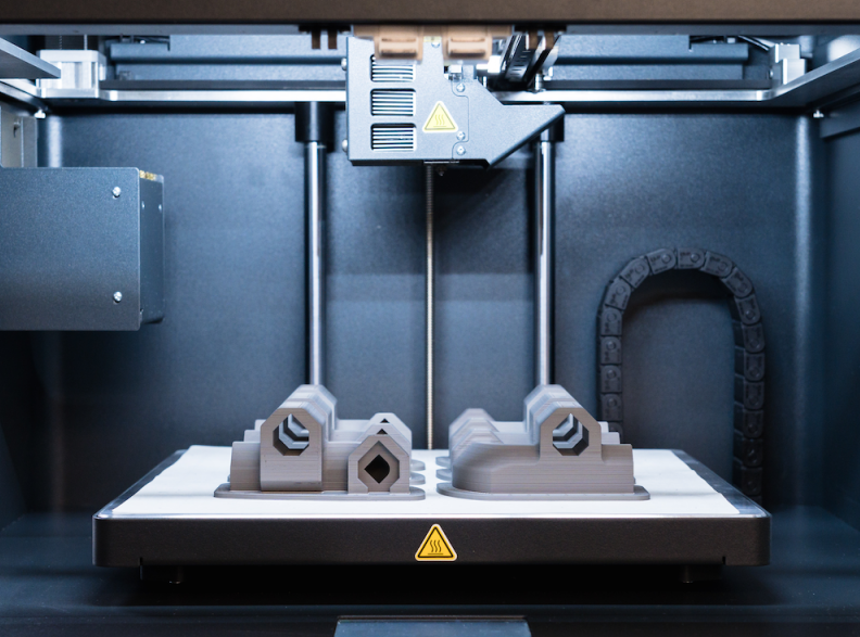 Parts being produced inside a Markforged Metal-X 3D printer.