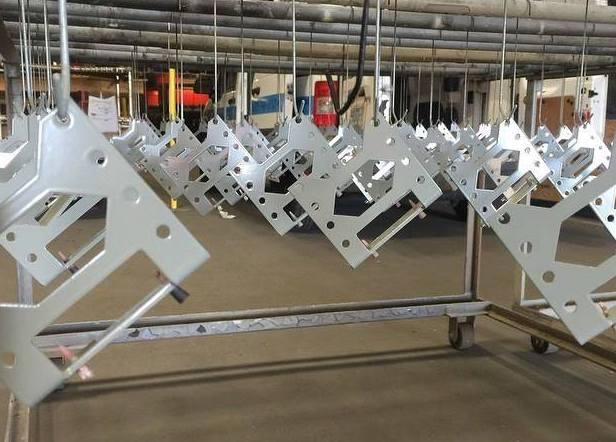 A set of hanging Prototek sheet metal fabricated parts.