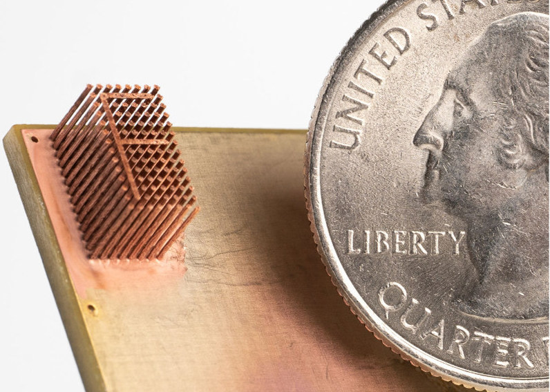 A micro-printed 3D structure produced using Fabric8Labs' technology.