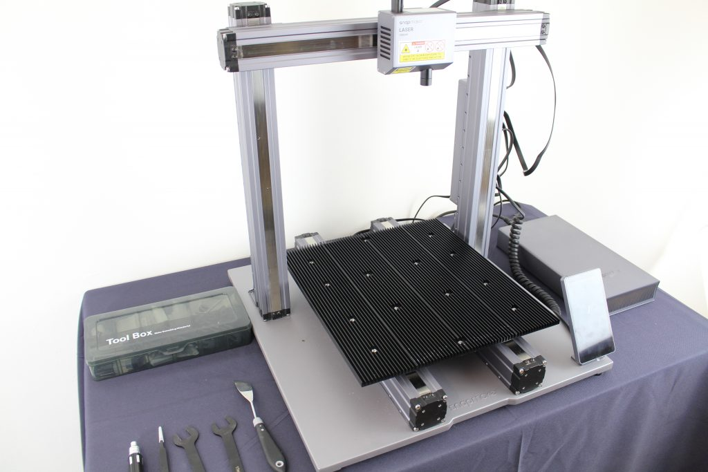 The aluminum lasering table. Photo by 3D Printing Industry.