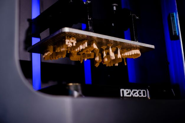 Dental prosthetics being printed using Nexa3D's new xMODEL 2505 material.